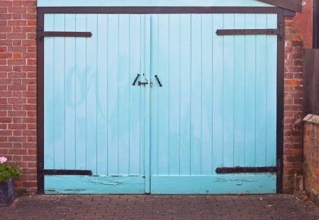 A vibrant blue garage door as a background image photo