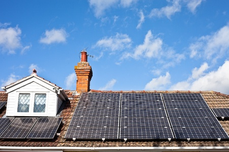 Modern solar panels on a house roof photo