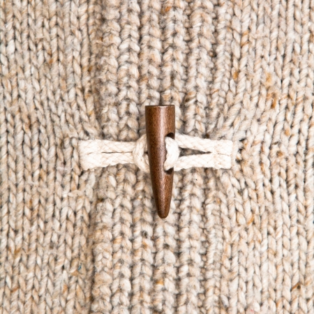 Close up of the toggle on a warm winter jumper Stock Photo - 15761601