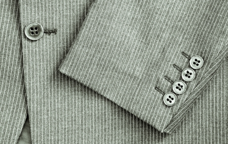pin stripe: Close up of sleeve and center of a pin stripe suit in black and white Stock Photo