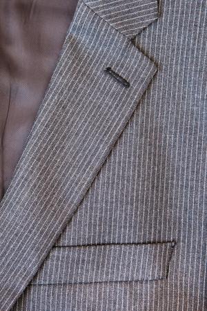breast pocket: Close up of the collar and breast pocket of a pin stripe suit Stock Photo