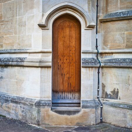 A medieval wooden door in a church wall in England Stock Photo - 15996143