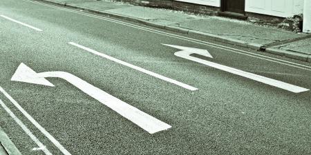 Left and right road arrows in black and white Archivio Fotografico
