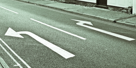 which: Left and right road arrows in black and white Stock Photo