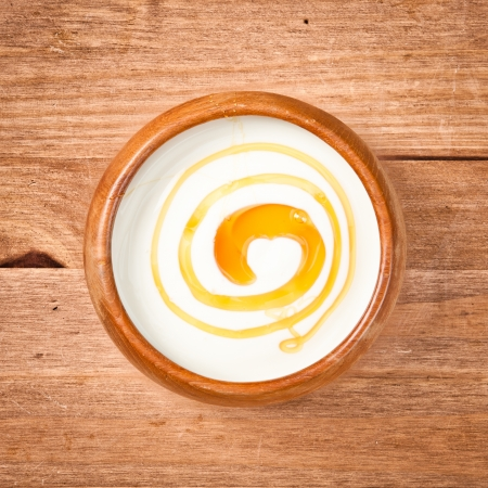 A bowl of greek yogurt with honey