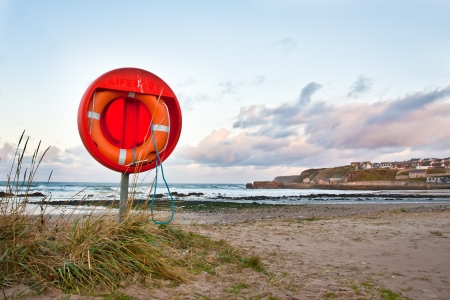 safety device: An emergency floatation device at a beach in Scotland Stock Photo