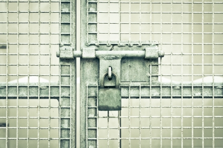A padlocked metal gate in dramatic monochrome Stock Photo - 16772192
