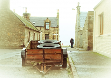 A wooden trailer on a scottish street in the winter fog photo