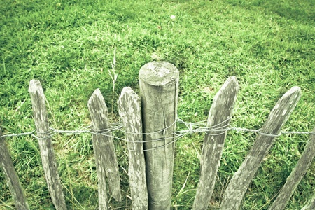rickety: Close up of a rickety wooden picket fence