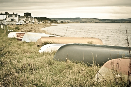 Upside down rowing boats in Findhorn, Scotland photo