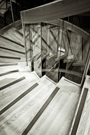 A spiral wooden staircase in monochrome tones photo