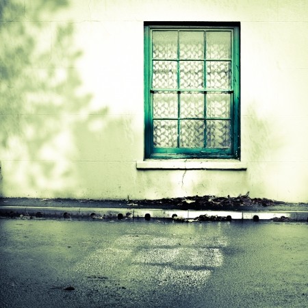 rainfall: Weathered window frame in a house after rainfall