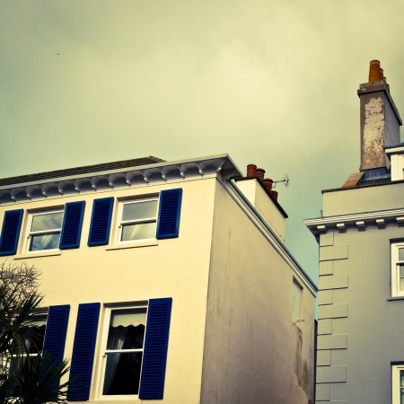 guernsey: Guernsey town houses in soft retro tones Stock Photo