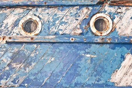 seafaring: Close up of the portholes on the side of an old fishing boat