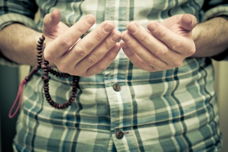 islamic pray: Hands of a young muslim man praying Stock Photo