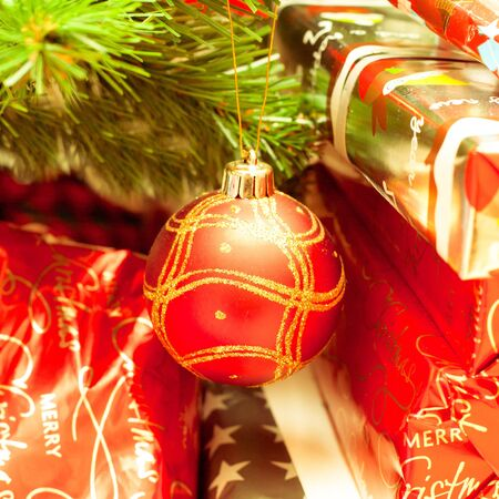 close up of christmas tree decorations and wrapped presents