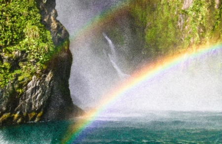 Rainbows and waterfall at Milford Sound, New Zealand Stock Photo