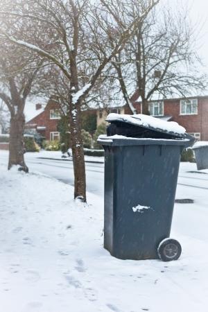 Black garbage bin for colection in an English neighbourhood