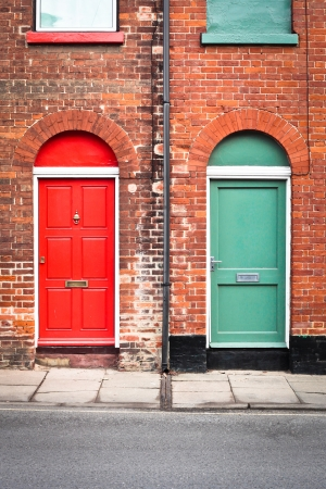 Colorful front doors of two adjoining town houses in England