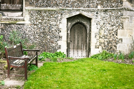 A quiet church garden with a bench photo
