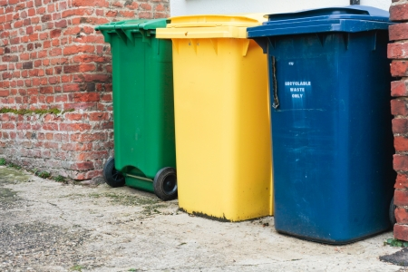 Three recycling bins outside a house in UK Stock Photo