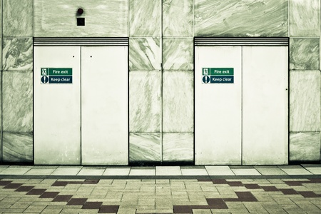 in need of space: Two fire exit doors in a modern urban building Stock Photo