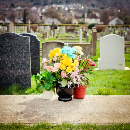 Bunch of fresh colorful flowers at a cemetery Stock Photo