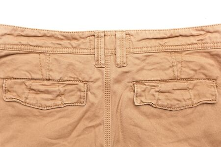 khaki pants: Mans trousers on white background showing rear pockets
