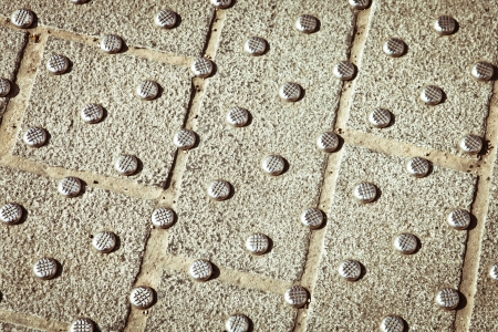 Metallic studs in concrete at a pedestrian crossing Stock Photo - 20477225