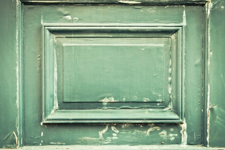 Peeling paint on a wooden door panel photo