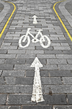 one lane sign: Cycle path in a city with yellow lines