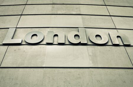 London sign on a modern concrete wall photo