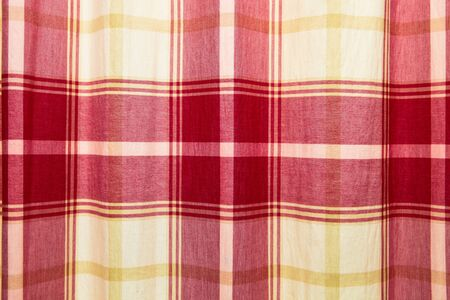 Red and yellow patterned curtain cloth as a background photo