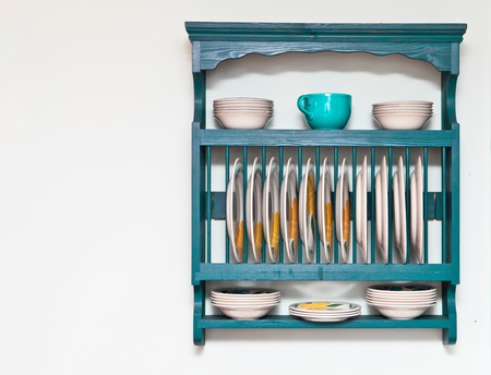 quaint: Plate and bowl rack in a cottage kitchen