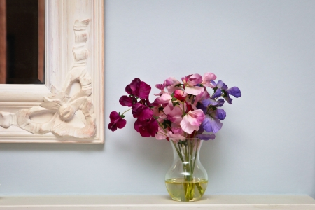 Flowers on a mantle piece in a vintage home photo