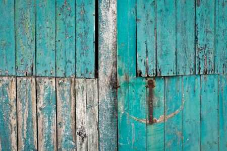 Close up of a weathered blue barn door photo