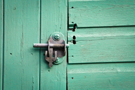Metal bolt lock on a blue painted shed door photo