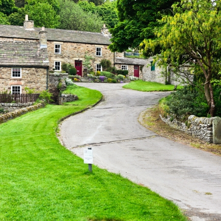 english countryside: Hillside stone cottages in Blanchland village, Northumberland Stock Photo
