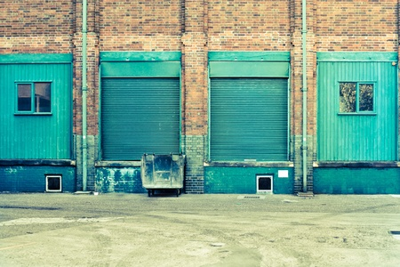 Blue doors and windows at the back of a factory photo