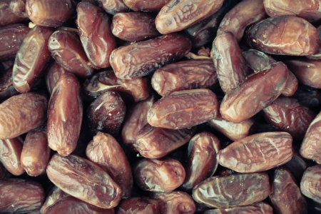 deglet: Selection of fresh Tunisian dates as a background