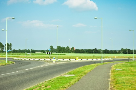 Modern road and roundabout in rural England Stock Photo
