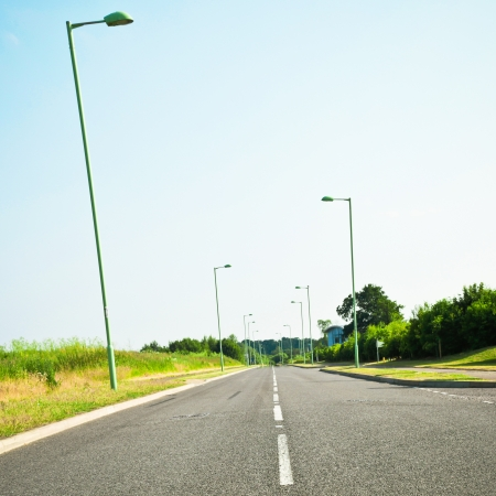A modern road in rural England in summer Stock Photo
