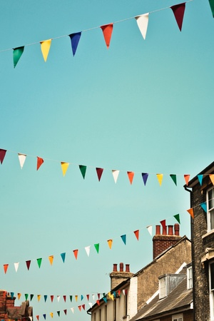 Bunting against a blue summer sky in a UK town photo