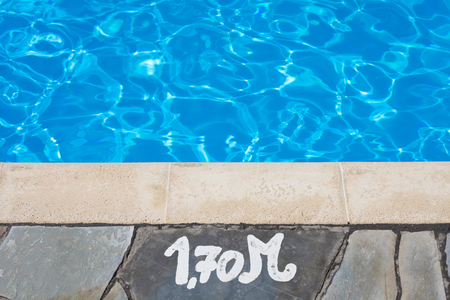 depth measurement: Depth notice at the edge of a swimming pool Stock Photo