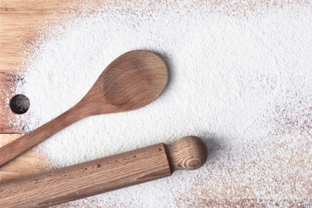 Baking items and flour on a wooden surface