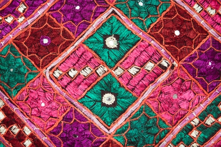 colord: Close up of a colorful Indian cloth as a background Stock Photo