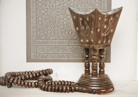 Islamic art and prayer beads with an incense burner, suggesting a meditative theme Stock Photo