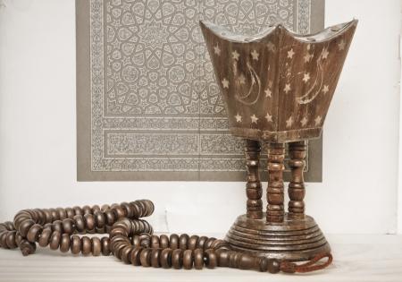 wood burner: Islamic art and prayer beads with an incense burner, suggesting a meditative theme Stock Photo