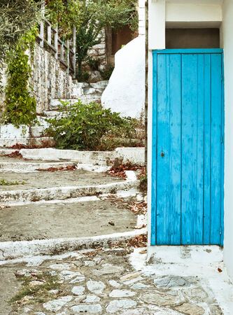 white washed: Bluie doorway and white washed steps in an old Greek village Stock Photo