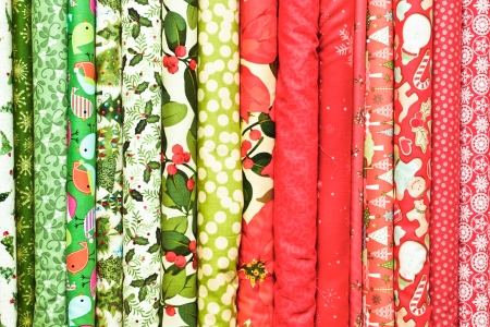 vibrant background: Rolls of colorful christmas fabric as a vibrant background image Stock Photo